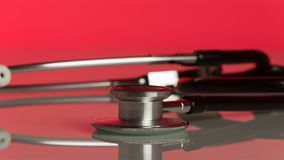 Medical diagnostic tool phonendoscope on red. Background Royalty Free Stock Photos