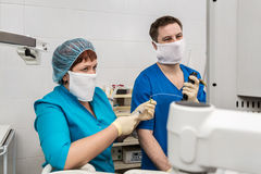 Medical diagnostics room. The doctor and nurse make bronchoscopy stock images