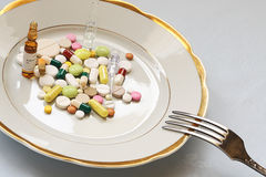Medical dinner. Course of medical treatment on white dinner plate royalty free stock photo
