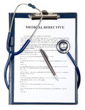 Medical directive document with stethoscope. Medical directive document in a clipboard with stethoscope isolated on white Royalty Free Stock Photos