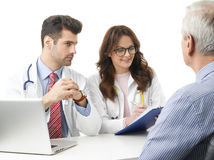 Medical discussion at hospital with elderly patient Stock Photography