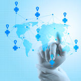 Medical Docto rhand  pointing at a world map as medical network Royalty Free Stock Photos