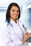 Medical doctor. Young female doctor on white background Royalty Free Stock Photos