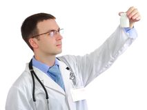 Medical doctor. Friendly medical doctor with blank pill's bottle. Close-Up. Isolated over white background Stock Photo