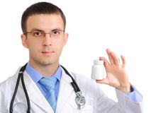 Medical doctor. Friendly medical doctor with blank pill's bottle. Close-Up. Isolated over white background Stock Image