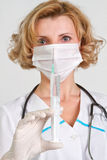 Medical doctor. Young medical doctor with syringe Royalty Free Stock Photo