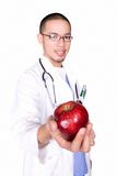 Medical Doctor. Holding a red apple royalty free stock image