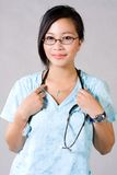 Medical doctor. The Medical doctor with her stethoscope royalty free stock photography