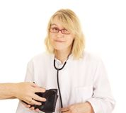 A medical doctor accepts funds Royalty Free Stock Image