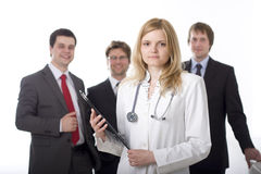 Medical doctor and the administration. Medical doctor with stethoscope and the administration in the background royalty free stock images
