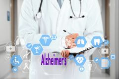 Medical Doctor and Alzheimer`s sign in Medical network connection on the virtual screen on hospital background. Technology and medicine concept Stock Images