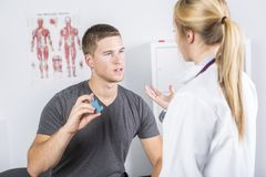 Medical doctor applying oxygen treatment on a sporty men. A Medical doctor applying oxygen treatment on a sporty men royalty free stock photos