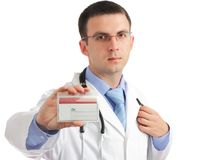 Medical doctor with blank mediical ID's card. Stock Photos