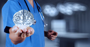 Medical  doctor with brain3d meatl in his hands Stock Photos