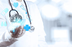 Medical doctor with brain3d metal in his hands Stock Photo