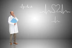 Medical doctor and cardiogram Royalty Free Stock Photography