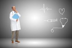 Medical doctor and cardiogram Stock Image