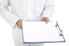 Medical doctor with clipboard Royalty Free Stock Photos