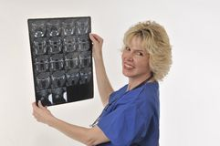 Medical Doctor and CT Scan. Mature woman medical specialist inspecting radiology result Royalty Free Stock Images