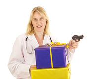 Medical doctor with gifts Stock Photos
