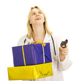 Medical doctor with gifts Stock Image