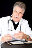 Medical doctor giving explanation to his patient Stock Photos
