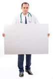 Medical doctor holding a big banner Royalty Free Stock Images