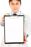 Medical doctor holding blank clipboard in hand Stock Photos
