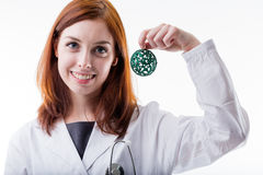 Medical doctor holding a christmas ball Royalty Free Stock Images