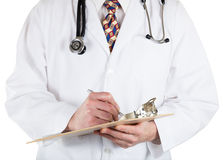 Medical doctor holding clip board and pen Stock Photos