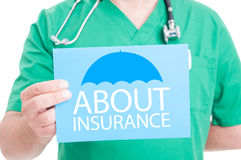 Medical doctor holding paper with information about insurance stock images