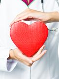 Medical doctor holding red heart Royalty Free Stock Photos