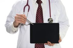 Medical doctor holding tablet facing the front on white background stock photography