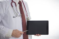 Medical doctor holding tablet facing the front on white background stock photos