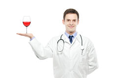 A medical doctor holding a wine glass Royalty Free Stock Photography