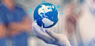 Medical Doctor holding a world globe in her hands. As medical network concept stock photo