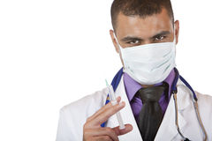 Medical doctor with injection, stethoscope, mask Royalty Free Stock Photography