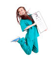 Medical doctor jumping with optometry chart Royalty Free Stock Photos