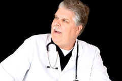 Medical doctor in a lab coat looking sideways Royalty Free Stock Photography