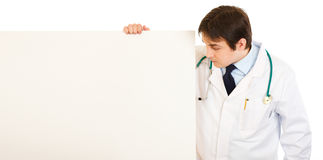 Medical doctor  looking at blank billboard Royalty Free Stock Images