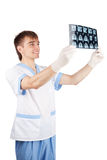 Medical doctor looking at computer tomography Royalty Free Stock Photos
