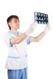 Medical doctor looking at computer tomography Royalty Free Stock Photos