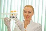 Medical doctor  looking on test tube with blood Stock Photography