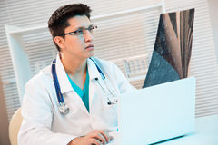 Medical doctor looking tomography scan Royalty Free Stock Photography