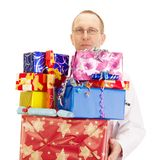 Medical doctor with a lot of gifts Royalty Free Stock Images