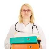 Medical doctor with a lot of work Royalty Free Stock Photo