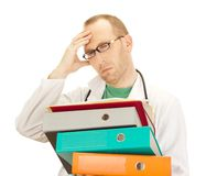 Medical doctor with a lot of work Royalty Free Stock Photos