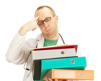 Medical doctor with a lot of work Stock Photo
