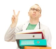 Medical doctor with a lot of work Royalty Free Stock Image