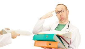 Medical doctor with a lot of work Stock Photography